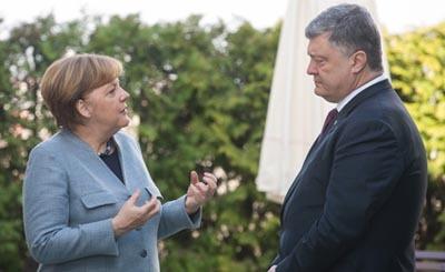 Встреча президента Украины П. Порошенко и канцлера Германии А. Меркель в Берлине © Михаил Палинчак / пресс-служба президента Украины / ТАСС. Предоставлено Фондом ВАРП
